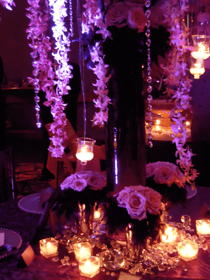 Close up of floral center piece crystals and rich linens I was in love