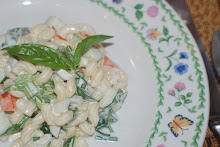 Macaroni salad with basil, orange bell peppers and celery