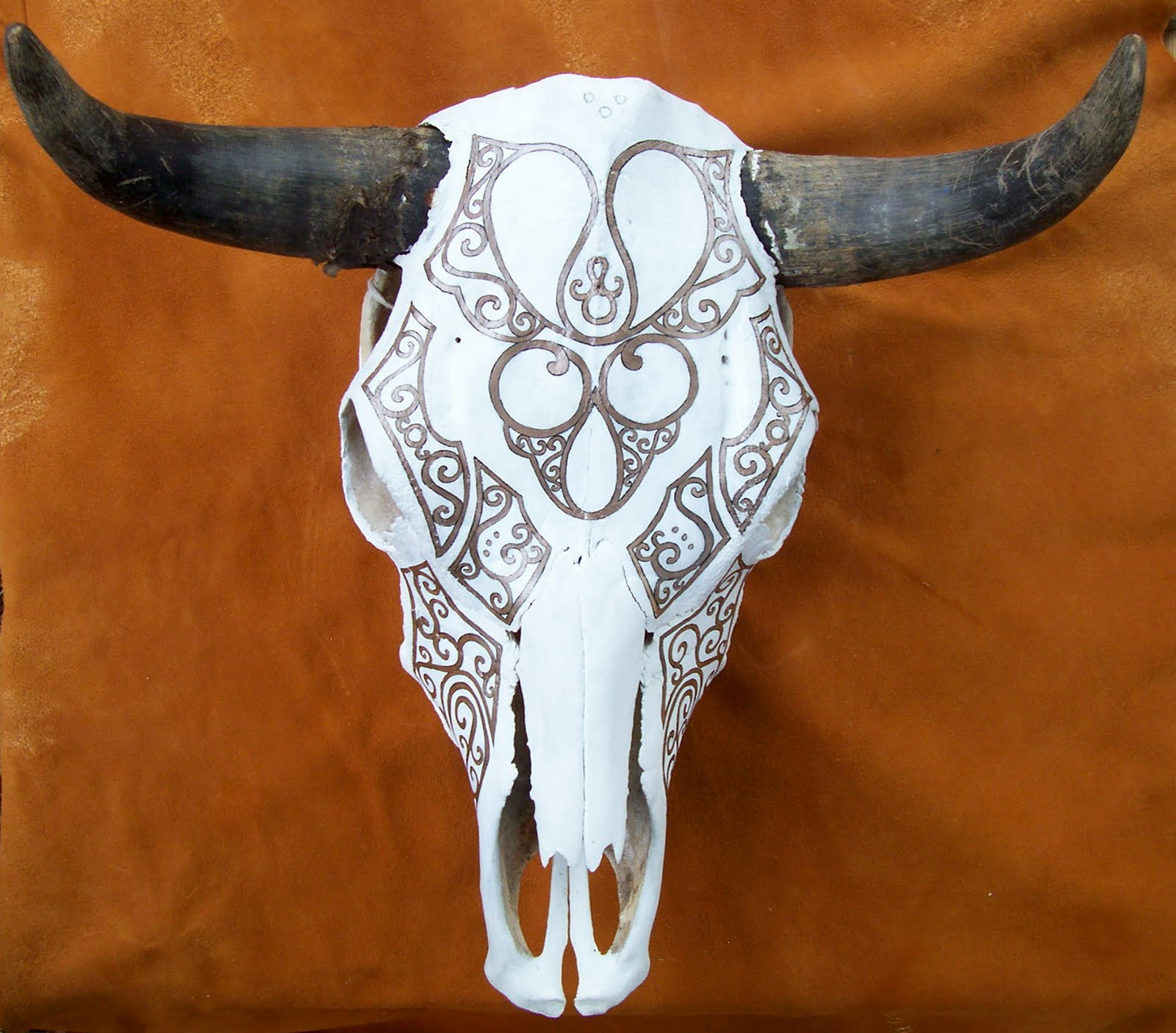 Pictures of Painted Cow Skulls http://wizartbyoonagh.blogspot.com/2010/09/painted-cow-skull.html