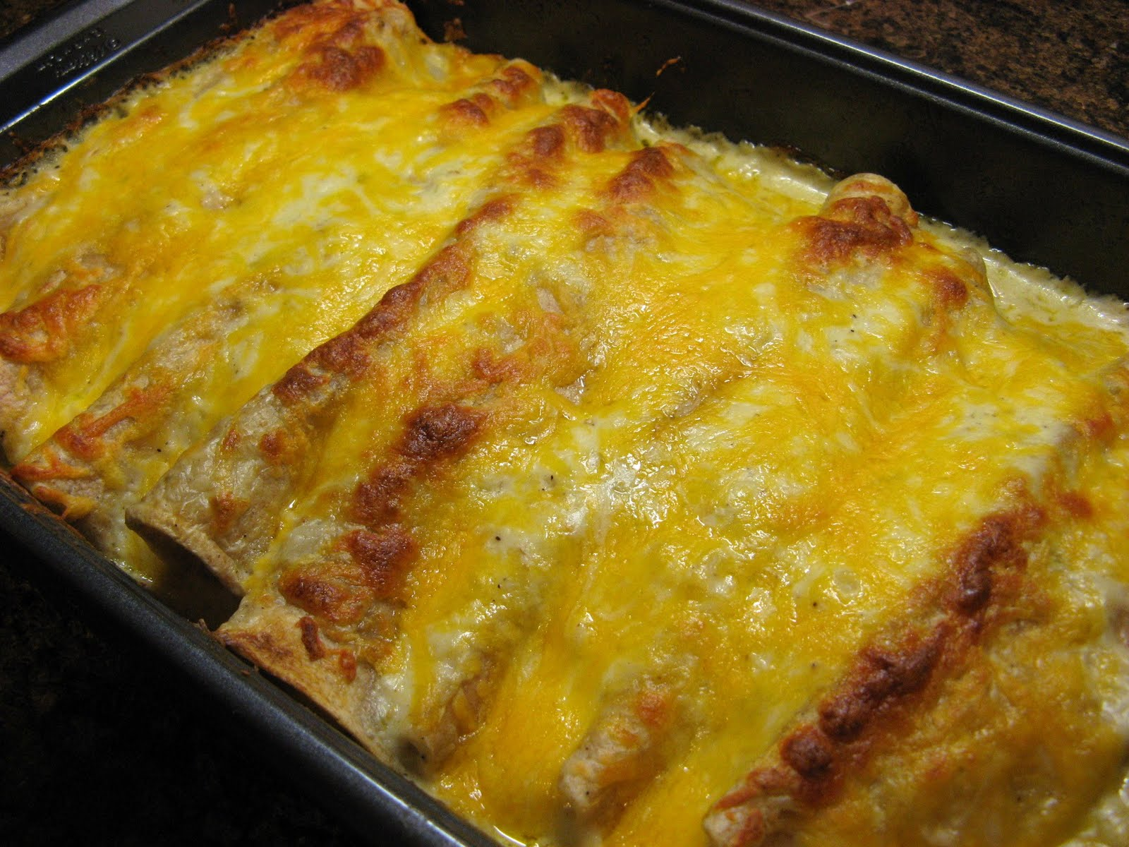 The Well-Fed Newlyweds: Creamy Green Chile Chicken Enchiladas