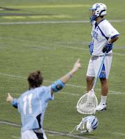 Duke goalie Dan Loftus, top, stands as Johns Hopkins' George Castle celebrates