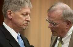 Former Durham District Attorney Mike Nifong speaks with attorney Jim Glover during recess