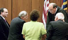 Jim Glover (ctr l) and Ann Petersen (ctr r), Judge W. Osmond Smith III, (2nd fm rt), prosecutors Charles Davis (r) and Boyd Sturges III (l)