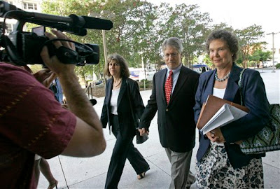 Mike Nifong (ctr), wife Cy Gurne Gurney (left), attorny Ann Peterson (rt)