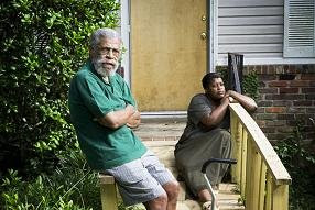 George Mitchell and his daughter Chandra Chavis in front of his home in Atlanta's Westwood neighborhood