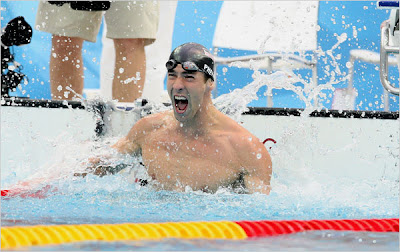 Michael Phelps celebrates victory in 100m butterfly, photo