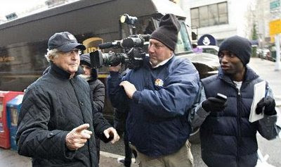Bernie Madoff runs into media scrum as he returns to his NY City apartment from court
