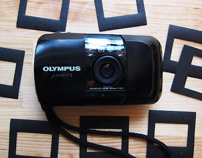 OLYNPUS POINT AND SHOOT CAMERA. Photograph by Tim Irving