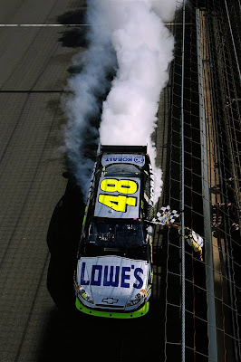 Jimmie Johnson burns out after winning the NASCAR Sprint Cup Series Allstate 400 at Indianapolis Motor Speedway