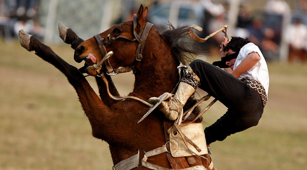 An Argentine gaucho competes during a rodeo in Jauregui, Argentina