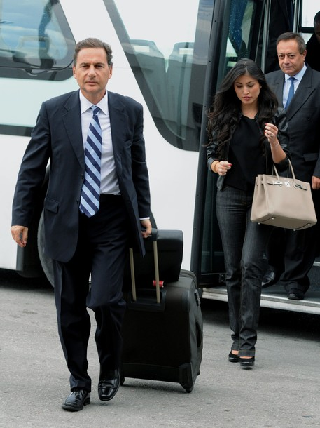 Eric Besson  takes off a bus upon his arrival in Tunis-Carthage airport with his Tunisian wife Yasmine Torjman