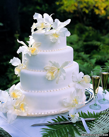 White Orchid Wedding Cake Voluptuous fresh cattleya orchids spill over a