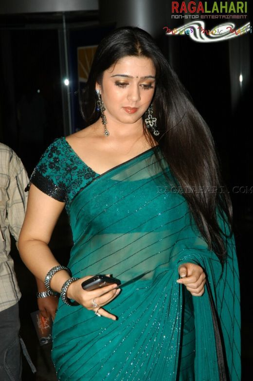 Actress Charmi in Peacock blue Transparent Saree and designer blouse