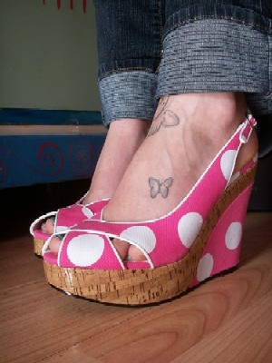 Butterfly · Girl · Tattooed feet in flip-flop