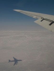 NASA's DC-8 casts a shadow on Arctic ice during a campaign in 2008 to measure the presence of pollution from mid-latitude continents and smoke and soot from wildfires in the Arctic atmosphere