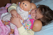 And she loves her baby dolls. ~~~~~ I thought about my children's reaction . (grace sleeping with her babies )