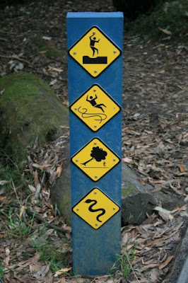 Funny Warning Sign, Great Ocean Road, Victoria, Australia - © CKoenig
