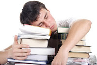 male office worker sleeping atop a pile of books, sleep, tulog