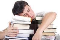 male office worker sleeping atop a pile of books, sleep, tulog