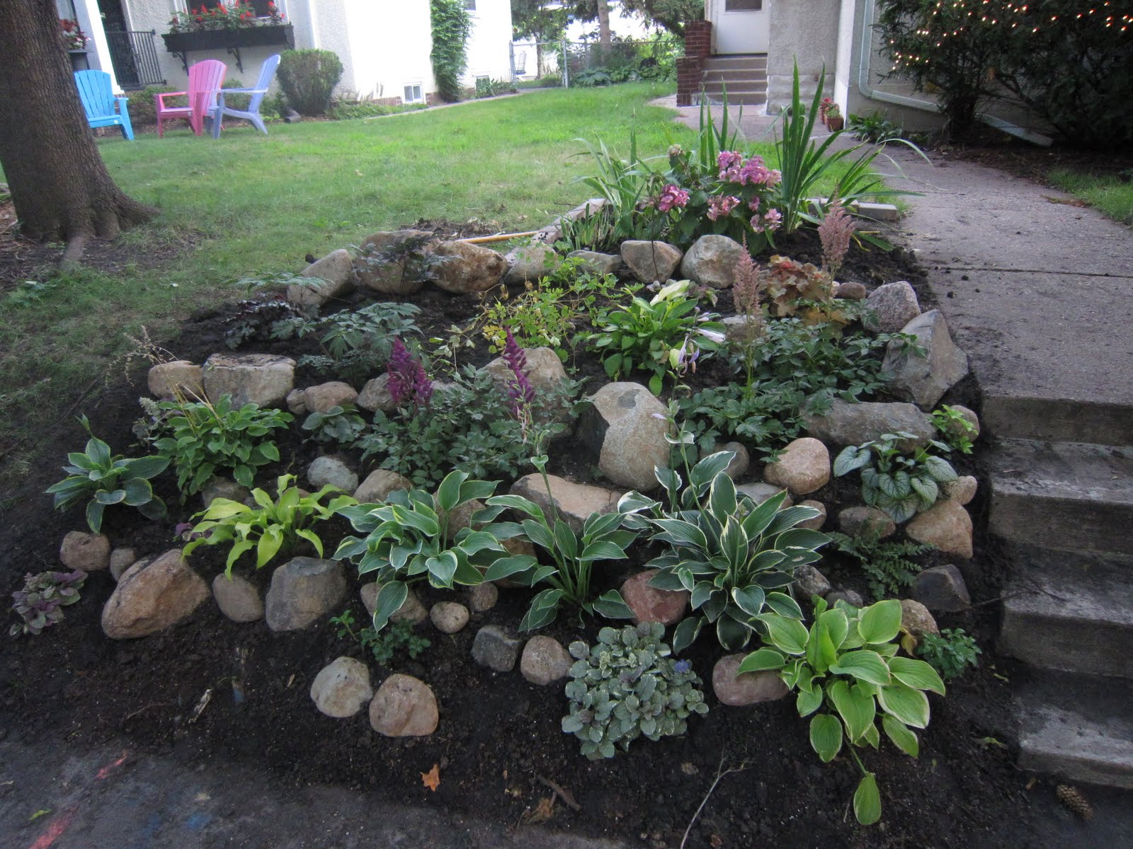 Chuck does art landscaping shady hillside for Hillside rock garden designs