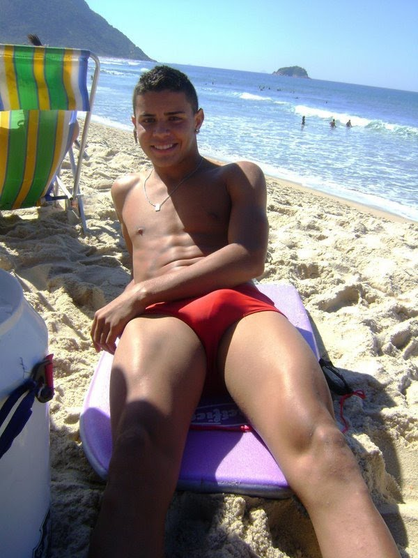 hot guy laying on the beach