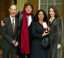 Sir Mick at Buckingham Palace with dad and two daughters