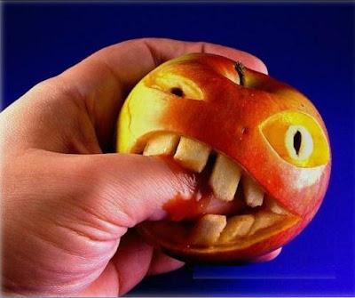 Hand Biting Unusual Apple
