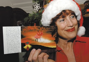 Patty Dean shows a greeting card from Chet Fitch