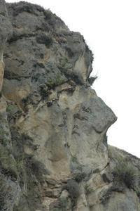 A rock formation that looks like a face