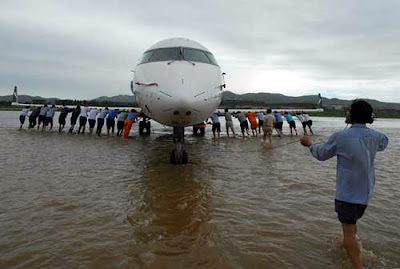 Airplane being push out of flooded areas