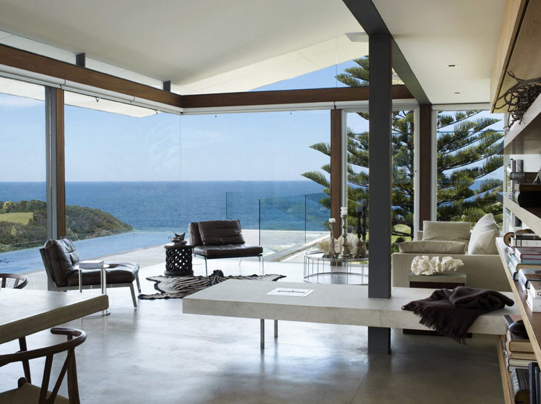 Contemporary-luxury-living-room-interior-design-with- modern-sofas-design-and-beautiful-sea-view-deisgn-ideas.