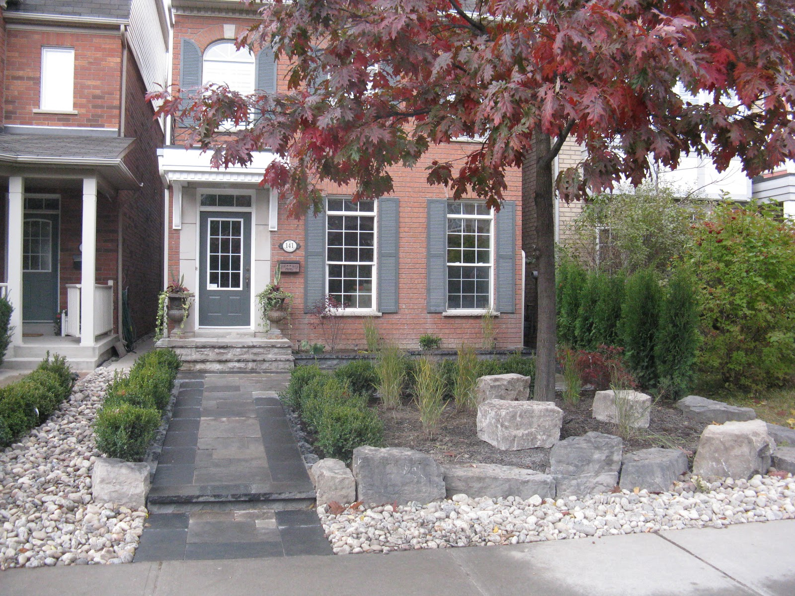 backyard and front entrace design build toronto landscaping company