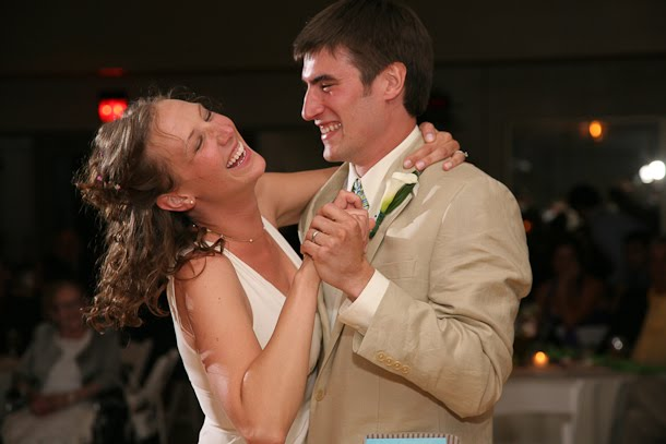Ellie and John laughing during their first dance after their wedding in downtown Milwaukee at the Harbor Lights room