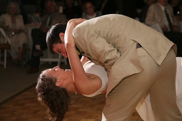 John dipping Ellie during their first dance at their wedding at the Harbor Lights room