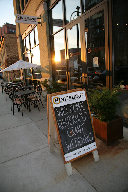 Sign board announcing Jonathan and Kristin's wedding reception at Hinterland Erie Street Gastropub in Third Ward