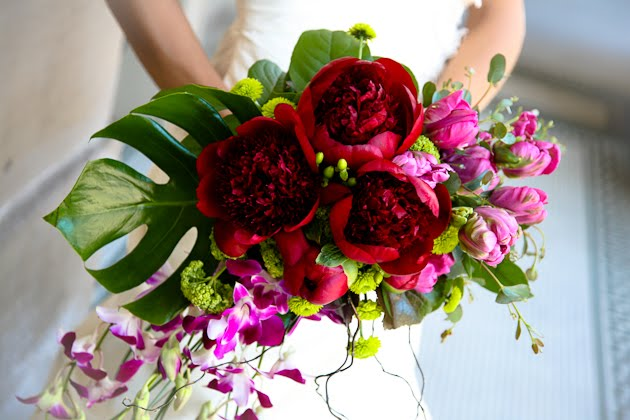 Bouquet of red flowers created by belle Fiori for Saz's Spring Wedding Showcase