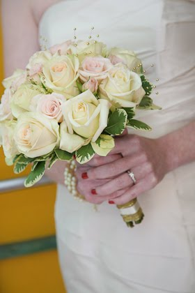 Bride holding bouquet from Christopher Mark Fine Flowers on her wedding day