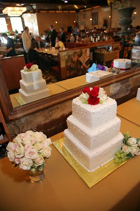 Wedding cake from Nielsen's Bakery reflected in mirror at Scoozi