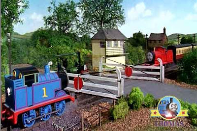James and Thomas waiting at an old wooden railway level crossing gate next to the railway signal box