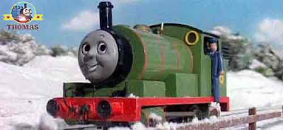 Green train Percy tank engine rushed to fetch bags special letters and colorful wrapped parcel gifts