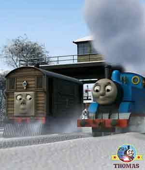 Thomas the tank engine and Toby the tram engine track junction building a gigantic snowman figure