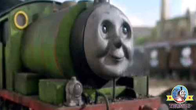 Green little Percy the train with wagon load of sugar going the candy and chocolate crunch factory