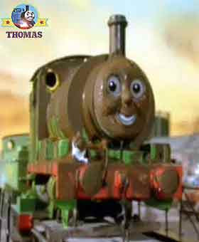 Steam tank engine Percy covered in chocolate crunch mix at wooden Tidmouth Sodor roundhouse sheds