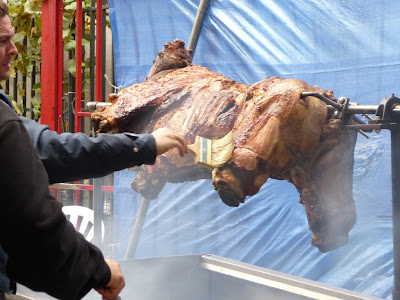 ... spit-roasting an entire cow in front of the restaurant. And, we swear