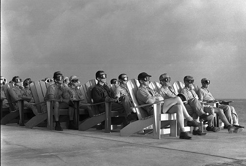 VIP observers are lit up by the light of an atomic bomb, Operation Greenhouse, Enewetak Atoll, 1951.