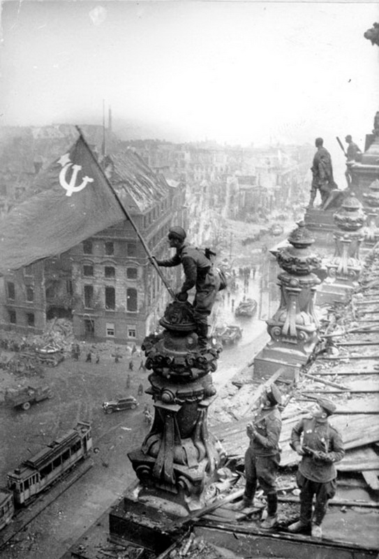 BERLIN. 1945 Soldiers%2Braising%2Bthe%2Bflag%2Bof%2BSoviet%2BUnion%2Bon%2Bthe%2Broof%2Bof%2BReichstag%2Bbuilding%2Bin%2BBerlin,%2BGermany%2Bin%2BMay,%2B1945