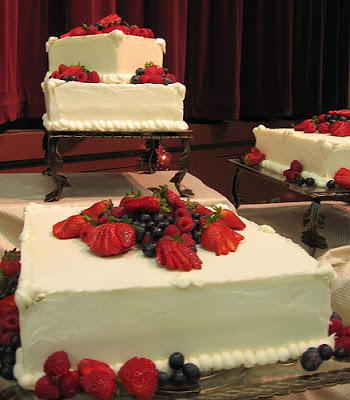 Square wedding cake with chocolate almost brownietasting on top and