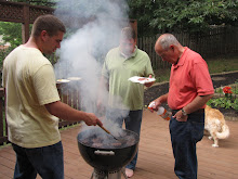 The men, the grill, and the smoke