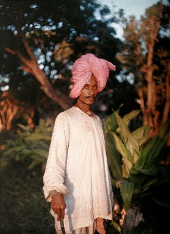 A man wearing a pink turban poses for a picture - 1926