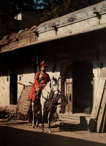A man sits on his horse in the street of the old city of Gwalior, Madhya Pradesh - 1926